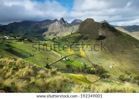 View of colorful terrace fields and scattering farms near Zumbahua village, Ecuador - stock photo