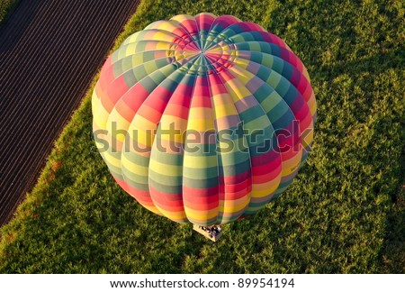 View of colourful hot air balloon from above, over Egypt at dawn - stock photo