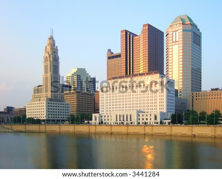 View of Columbus, Ohio skyline and Scioto River at sunset.