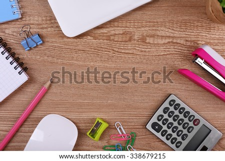 View of comfortable working place on wooden background - stock photo
