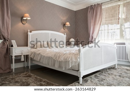 View of comfy bedroom inside a residence - stock photo