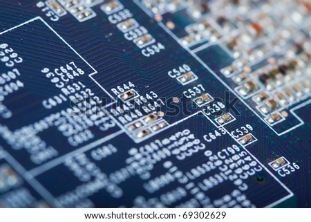 view of computer printed circuit as background. Shallow DOF - stock photo