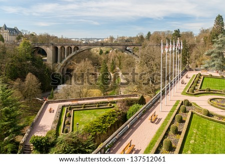 View of Constitution square and Adolphe Bridge in Luxembourg city - stock photo