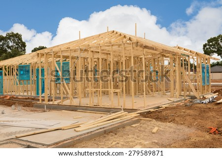 view of construction site house foundation and new home framing in preparation process - stock photo