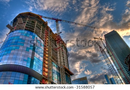 View of construction site with towers and crane. - stock photo