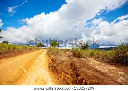 View of country road with blue sky. Venezuela