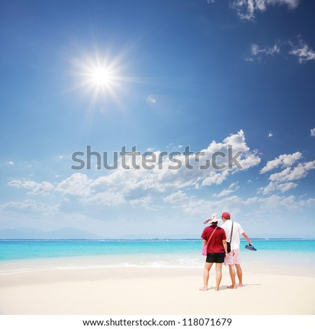 view of couple look at sea - stock photo