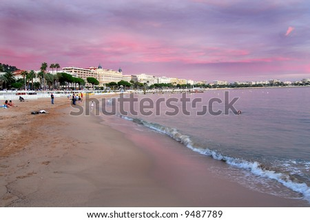 View of Croissette Beach in Cannes taken at dusk. - stock photo