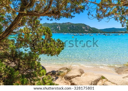 View of crystal clear turquoise sea water of Santa Giulia beach, Corsica island, France