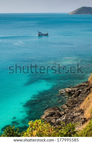 View of crystal sea with boat  - stock photo