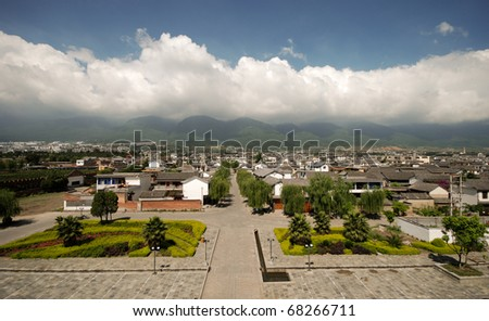 View of Dali city in Yunnan Province China, rooftops and mountains - stock photo