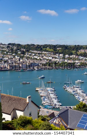 View of Dartmouth Devon and boats on Dart river with blue sky on summer day - stock photo