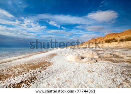 View of Dead Sea coastline and salt crystals - stock photo