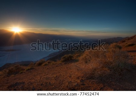 View of Death Valley from Dante's Peak at sunset, showing the salt pans below in Badwater. High dynamic range image from three blended exposures - stock photo