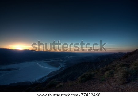 View of Death Valley from Dante's Peak just after sunset, showing the salt pans below in Badwater. High dynamic range image from three blended exposures