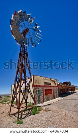 View of desolated bar with windmill in Route 66 - stock photo