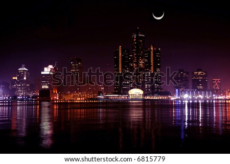 view of Detroit skyline at night and moon, Michigan - stock photo
