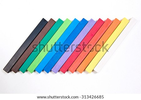 View of different color chalks pastel isolated on the white background. Drawing supplies: assorted color chalks pastel, isolated on white background. Abstract background from color chalks pastel. - stock photo