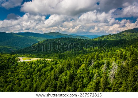 View of distant mountains and the Blue Ridge Parkway from Devils Courthouse in North Carolina. - stock photo