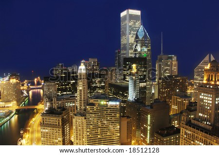 View of downtown Chicago at night from the top of Marina Towers. - stock photo