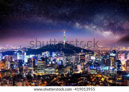 View of downtown cityscape and Seoul tower with Milky way in Seoul, South Korea. - stock photo