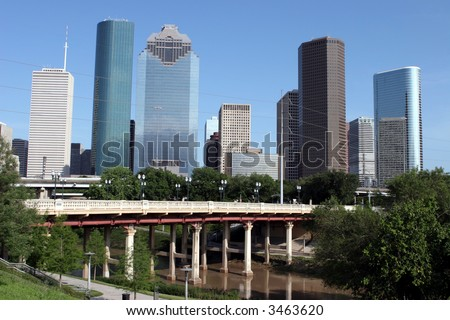 View of Downtown Houston and Buffalo Bayou bridge from a park