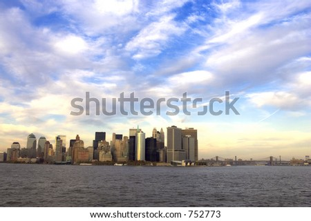 view of downtown manhattan at dusk from the statten island ferry, Manhattan bridge is to the right, manhattan, new york, America, usa