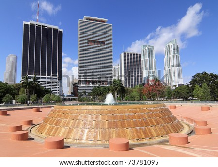 View of downtown Miami Skyline with offices and Apartments from Bayfront Park with the city's public  fountain in the foreground - stock photo