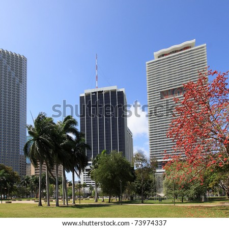 View of downtown Miami Skyline with offices and Apartments with Bayfront Park in the foreground - stock photo