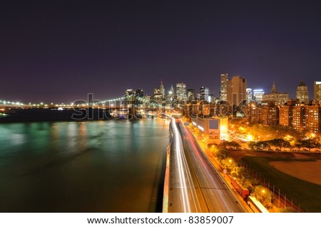 View of Downtown New York City and Brooklyn Bridge above FDR Highway - stock photo
