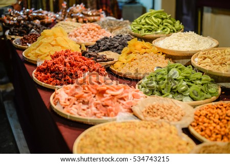 View of dried fruits and nuts in market. Various assortment natural colorful background