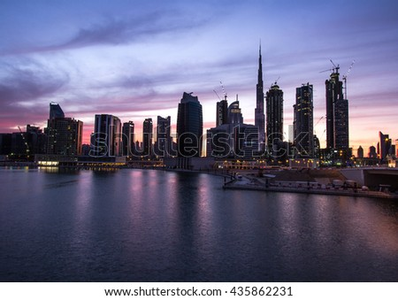 View of Dubai Downtown reflecting in water after sunset. Dubai, UAE - 23/FEB/2016