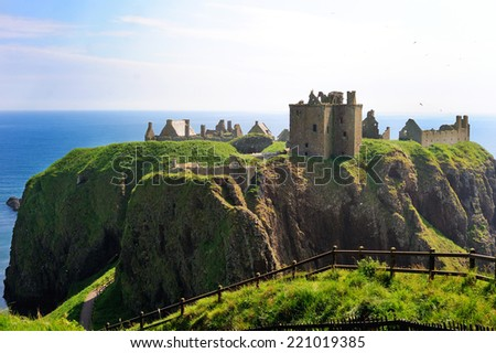View of Dunnotar castle on the sunny summer day, Stonehaven, Scotland - stock photo