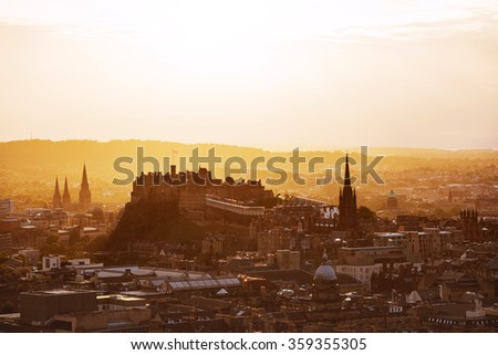 View of Edinburgh castle from Arthur's Seat peak at sunset. - stock photo