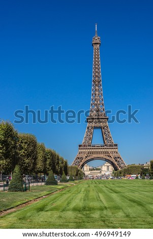 View of Eiffel Tower (La Tour Eiffel). Eiffel Tower is tallest structure in Paris and most visited monument in world. Champ de Mars, Paris, France.