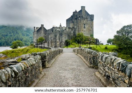 View of Eilean Donan Castle, Scotland in cloudy day with dramatic light - stock photo