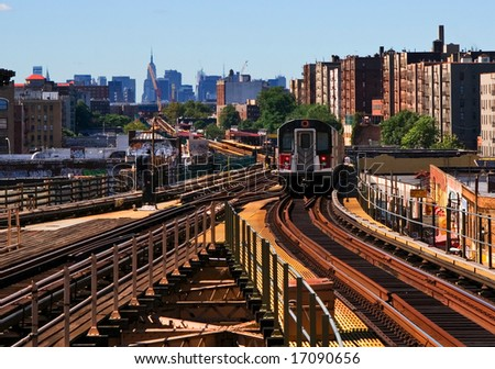 View of elevated train on downtown route to the city. - stock photo