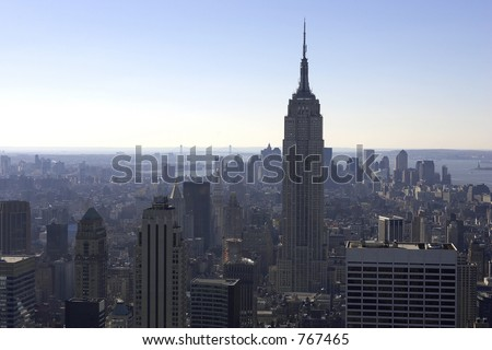 View of empire state building and downtown manhattan from the roof of the rockefeller building, new york, america, usa - stock photo