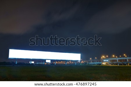 View of empty billboard at night for advertisement.