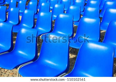View of Empty blue chairs for outdoor cinema - stock photo