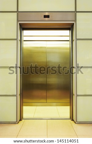 View of empty open elevator in office - stock photo