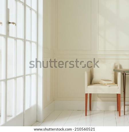 View of empty room with chair - stock photo