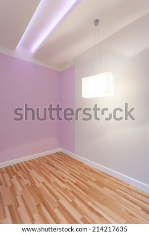 View of empty room with illuminated ceiling - stock photo
