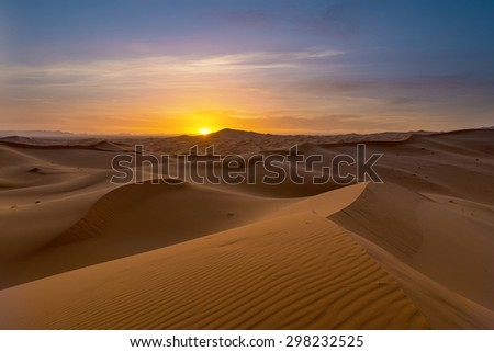 view of Erg Chebbi Dunes -  Sahara Desert - at sunset, in Morocco - stock photo
