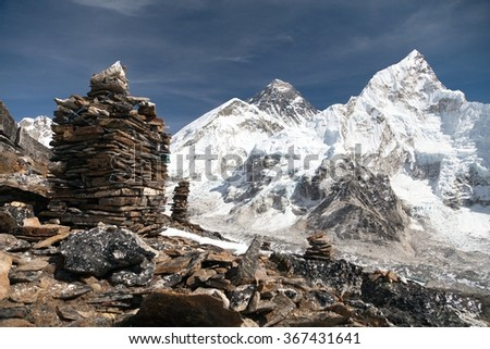 View of Everest and Nuptse from Kala Patthar with stone mans - way to everest base camp, Khumbu valley, Sagarmatha national park, Nepal  - stock photo