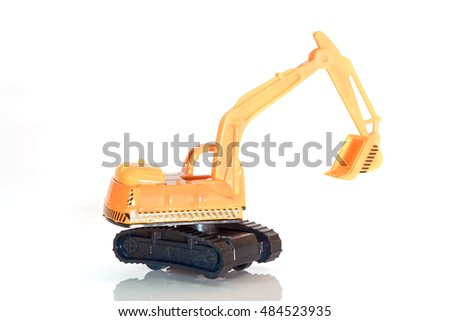 View of excavator machine toy on white background.