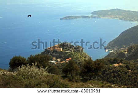 View of Eze, renown medieval village on the French Riviera.  On the upper right hand side of image is very famous Saint Jean Cap Ferrat - stock photo