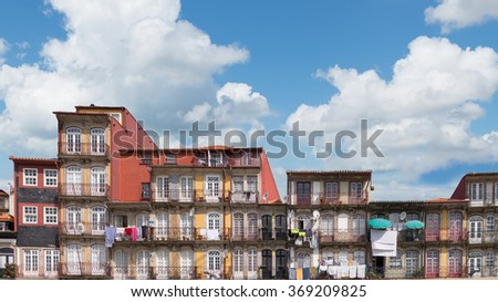 View of facades, alleyway and traditional houses in Ribeira old and historic town and alongside Douro River, Porto, Portugal - stock photo