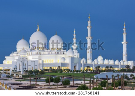 View of famous Abu Dhabi Sheikh Zayed Mosque by night, UAE. - stock photo
