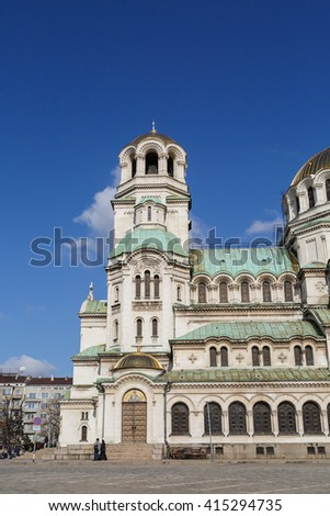 View of famous Bulgarian Orthodox church of Alexander Nevsky Cathedral built in 1882 in Sofia, Bulgaria, on blue sky background. - stock photo